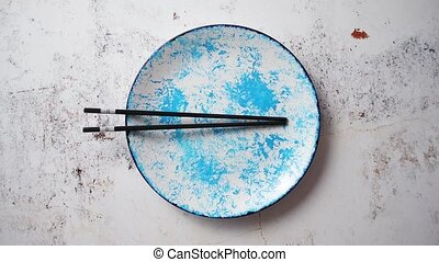 Blue hand painted ceramic serving plate with wooden...