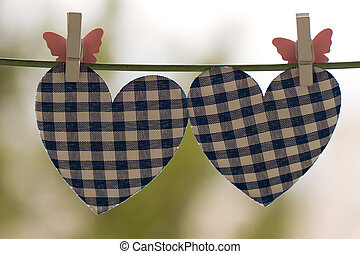 blue heart attached to a clothesline with pin