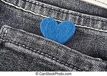 Blue heart in black jeans pocket