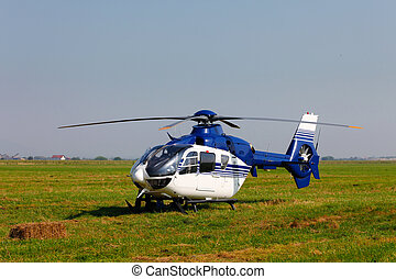 Blue helicopter on field