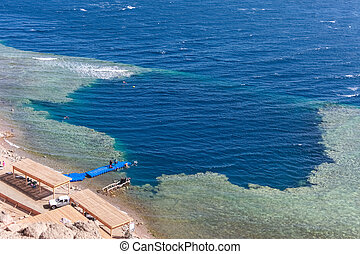 Blue Hole is a popular diving location on east Sinai, a few kilometres north of Dahab, Egypt on the coast of the Red Sea.