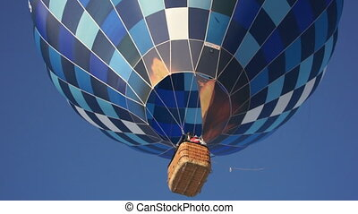 Blue hot air balloon flying in sky