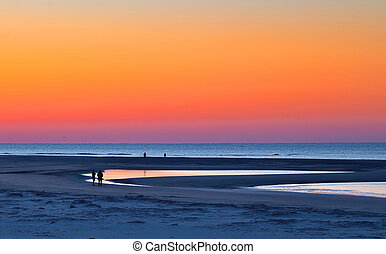 Blue Hour Beach Under Orange Sunrise