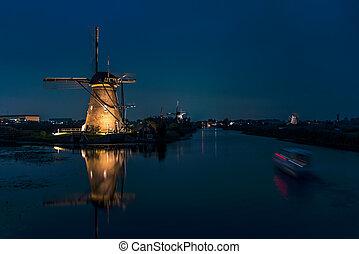 Blue hours sunset at Kinderdijk, the windmills farm listed in the UNESCO world heritage sites list at Alblasserdam, nearby Rotterdam, Netherlands