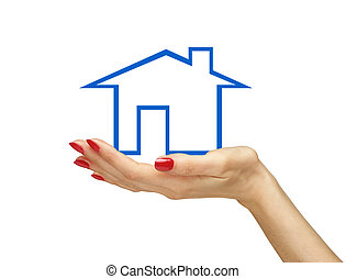 Blue house in woman hand isolated on white background. Real estate