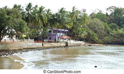 Blue house near the sea lagoon. - Blue house near the sea...