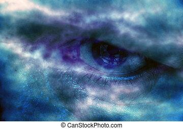 Blue human eyes closeup