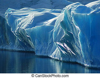 Blue Ice - A small part of the sun-reflecting blue front of...