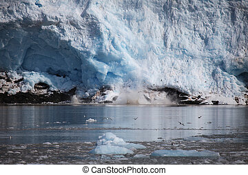 Blue ice and small icebergs. Glacier front in Svalbard, Norway