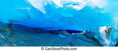 Blue ice cave of Svartisen Glacier in Norway