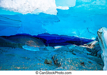 Blue ice cave of Svartisen Glacier, Norway