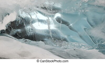Blue ice. Water melts and flows on ice HD