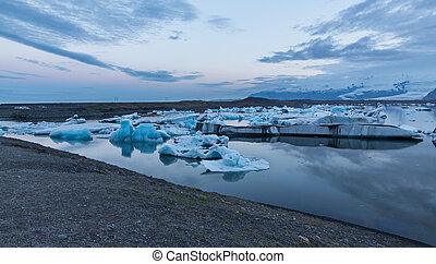 blue icebergs floating - Wide view of blue icebergs floating...