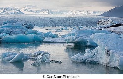 blue icebergs floating - Detailed view of blue icebergs...