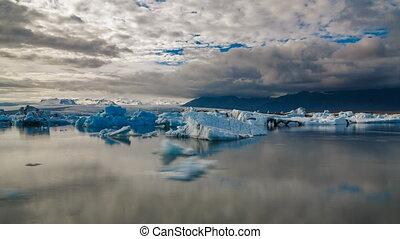 Blue icebergs floating time lapse in Jokulsarlon, Iceland -...
