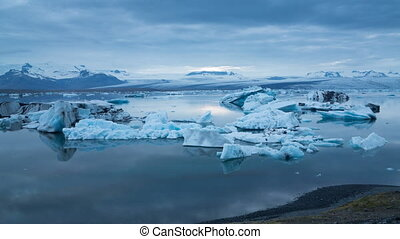 blue icebergs floating under midnight sun - 4k Version of...