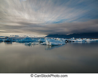 blue icebergs in lagoon, ultra long exposure