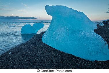 blue icebergs on the beach