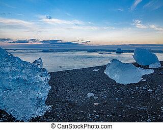 blue icebergs on the beach, ultra long exposure