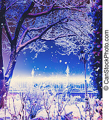 Blue illumination in city street. Snowfall. Holiday background