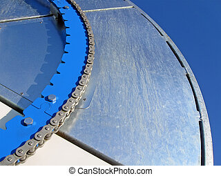 blue industrial metal wheel with steel chain, industry details