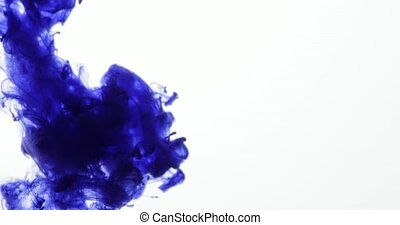 Blue Ink Colors in Water Creating Liquid Art Shapes