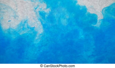 Blue ink in water. Creative slow motion. On a white background