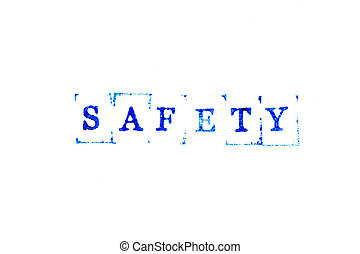 Blue ink of rubber stamp in word safety on white paper background