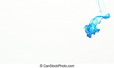 blue ink poured in water in slow motion