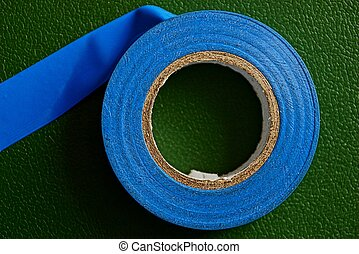 blue insulating tape on a green table - blue adhesive tape ...