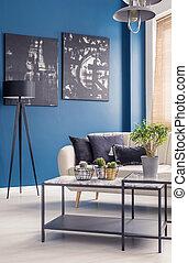 Blue interior with black art