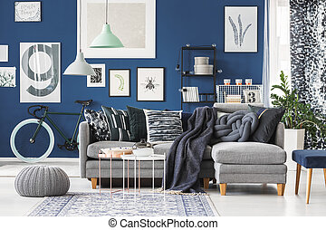 Blue interior with poster gallery