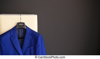 Blue jacket of groom on the hanger - Blue jacket of the...