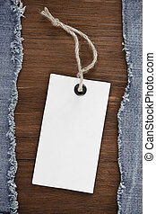blue jean on wood background - blue jean and price tag on...