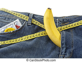 Blue jeans and banana with condoms, safe sex concept.