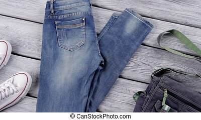 Blue jeans and denim purse. White canvas shoes and jeans....