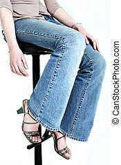 Close up of girl on stool in blue jeans