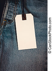 Blue jeans detail with blank tag