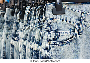 New blue jeans hanging in a shop