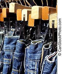 blue jeans on a rack