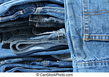Pile of trausers made of blue denim jeans