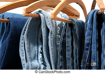 Trausers made of blue denim jeans hanging
