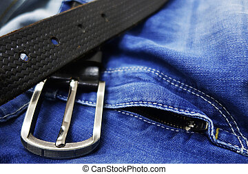Blue jeans with black leather belt