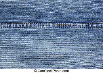 Blue jeans with yellow stitches background.