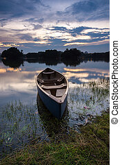 Blue kayak at the lake