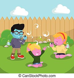 blue Kids playing soap bubbles at the backyard