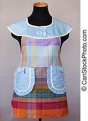 Blue kitchen female apron on mannequin
