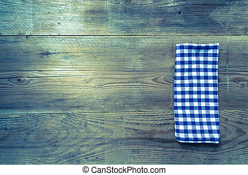 blue kitchen towel on rustic wooden background