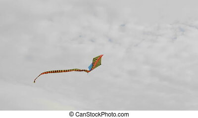 Blue kite soaring in the sky.
