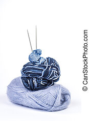 Blue knitting needles pyramid
